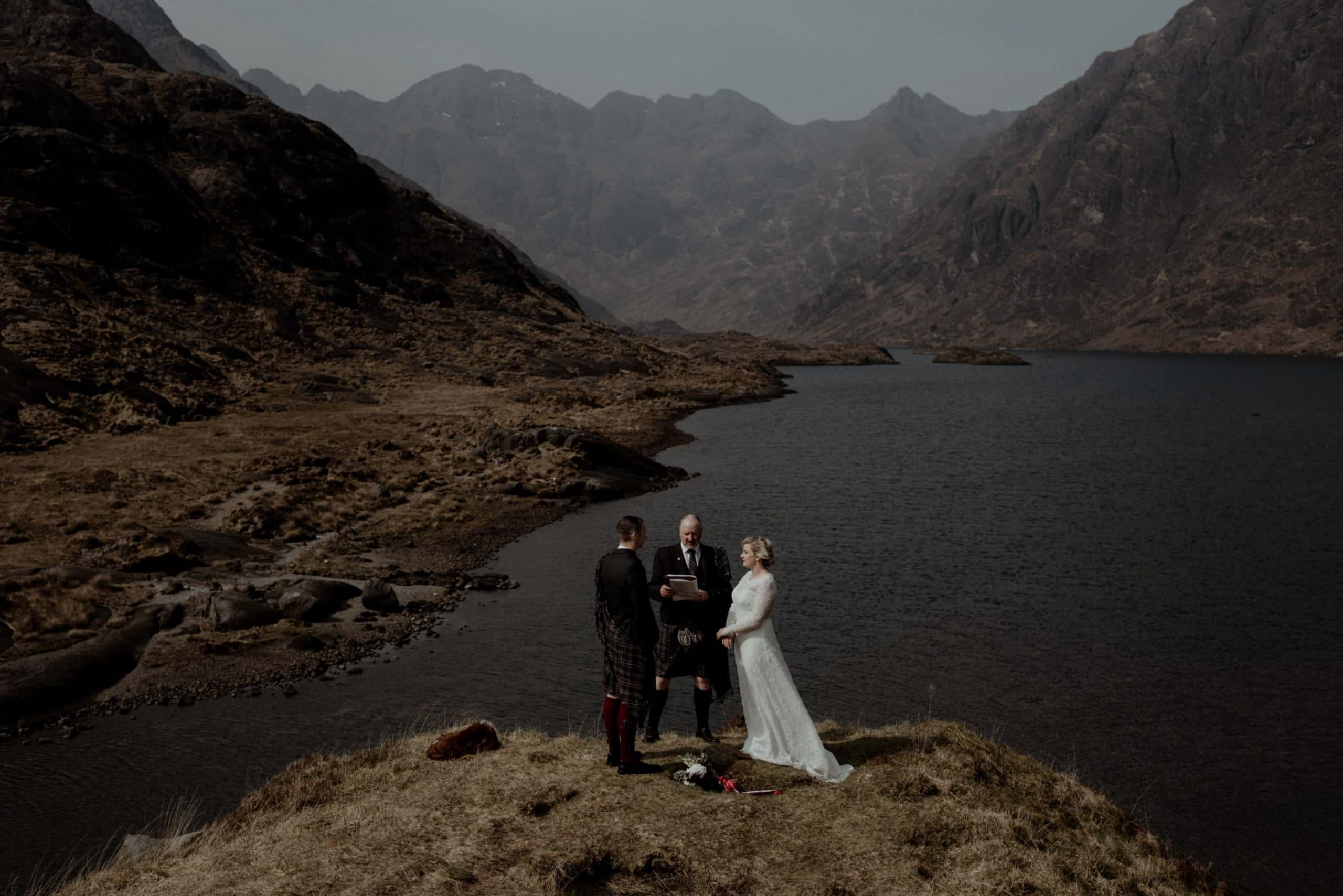 A ceremony on Loch coruisk during an elopement on Skye