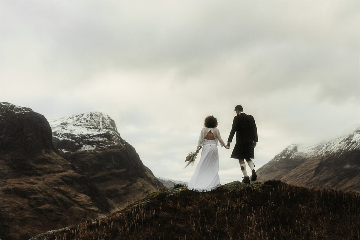 bride and groom dancing in Glencoe during their elopement in scotland