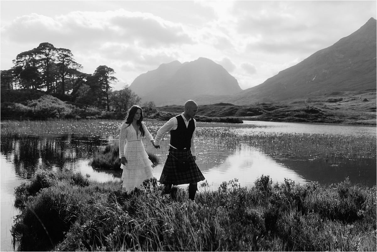 Bride and Groom who eloped to Scotland, walking in the mountains of Torridon