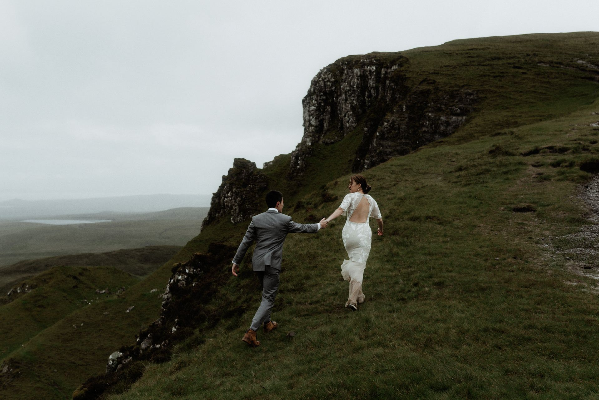 young couple walking on the Isle of Skye during their elopement