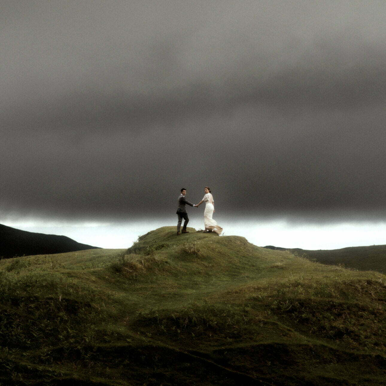 fairy glen isle of Skye with couple walking during their elopement on skye