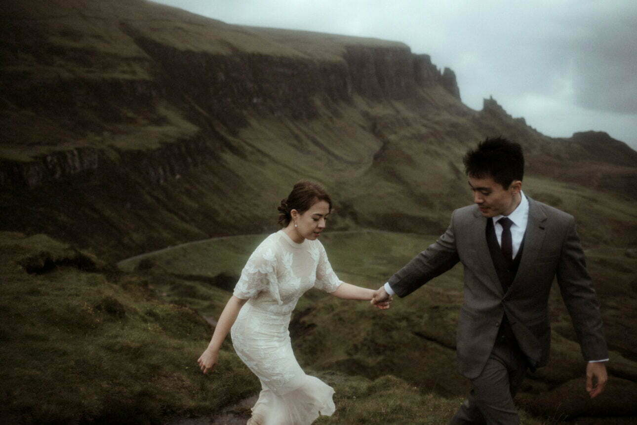 Couple walking on the Isle of Skye after their elopement in Scotland