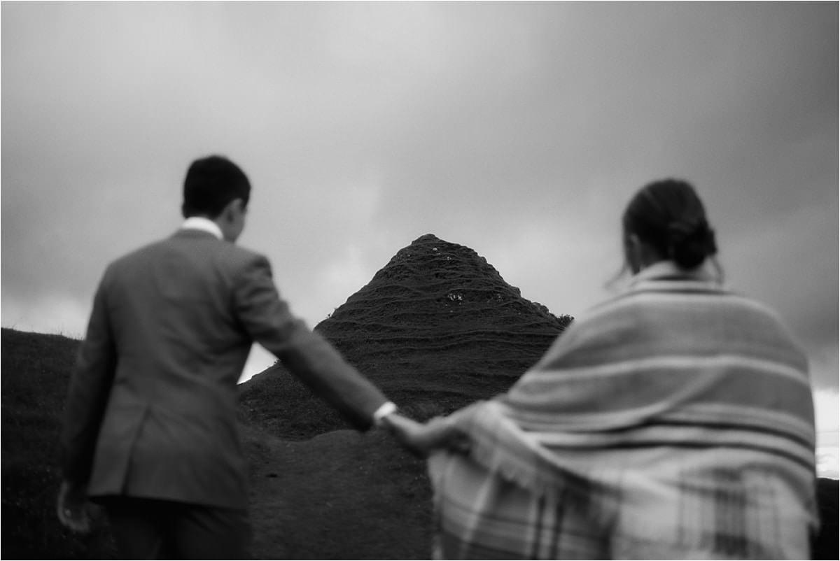 couple walking in the fairy glen on the isle of skye