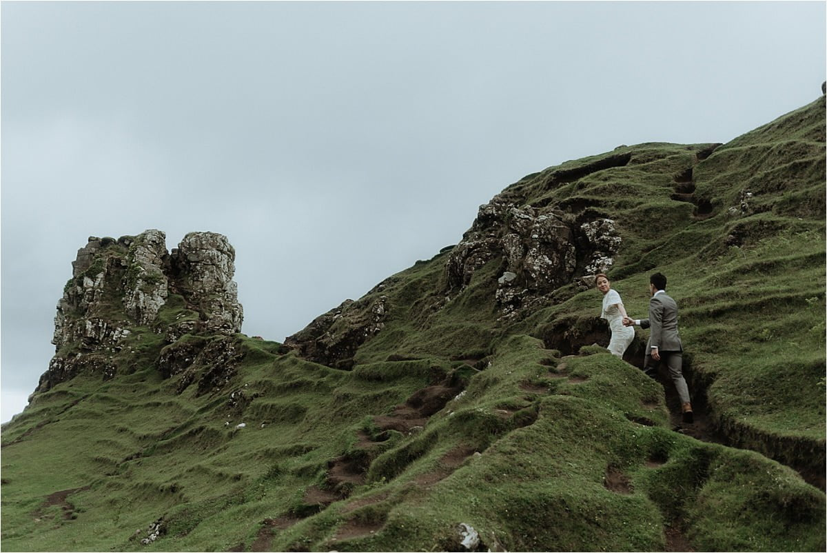 a couple walking at the fairy glen after they eloped to scotland