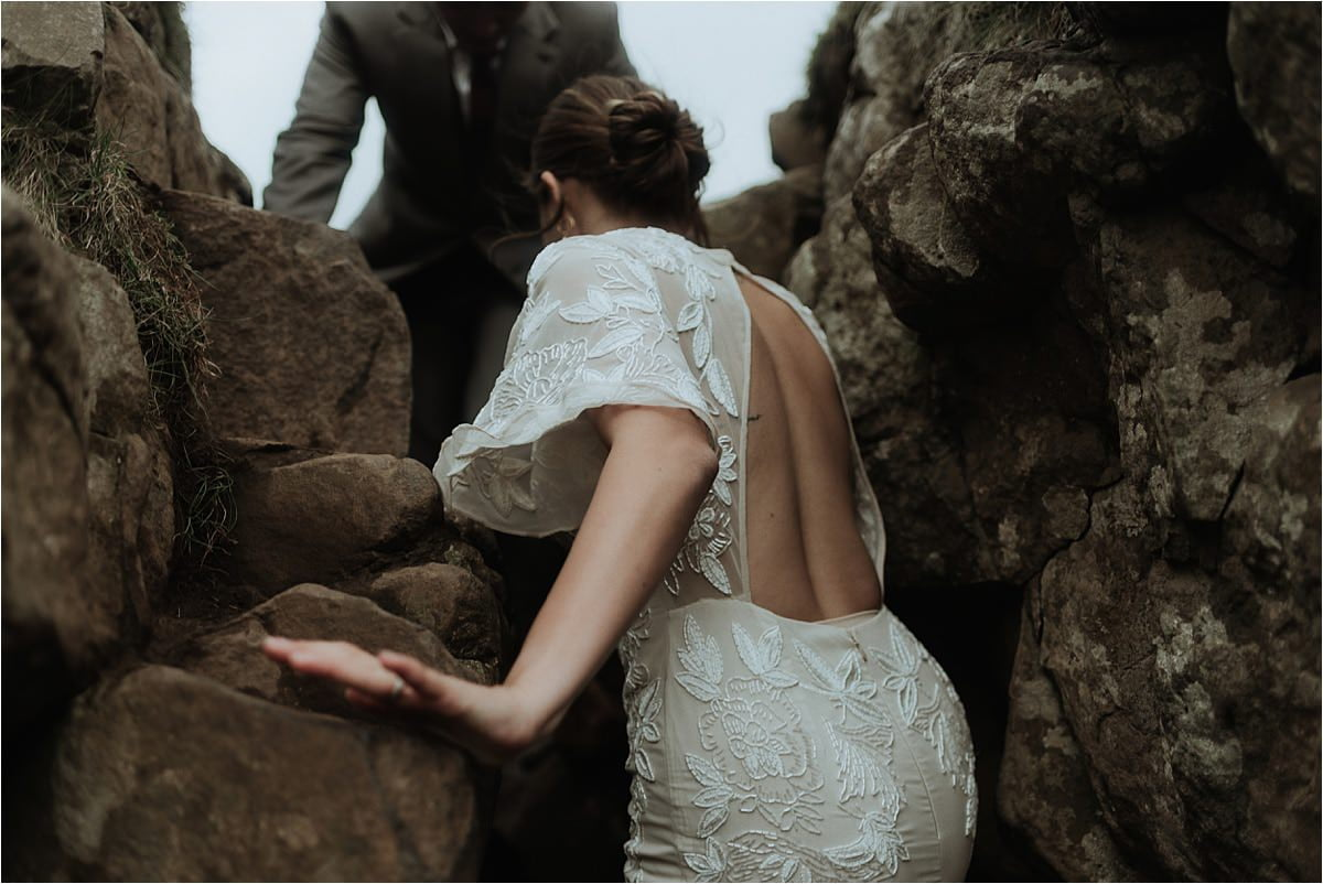couple climbing in the fairy glen after their elopement