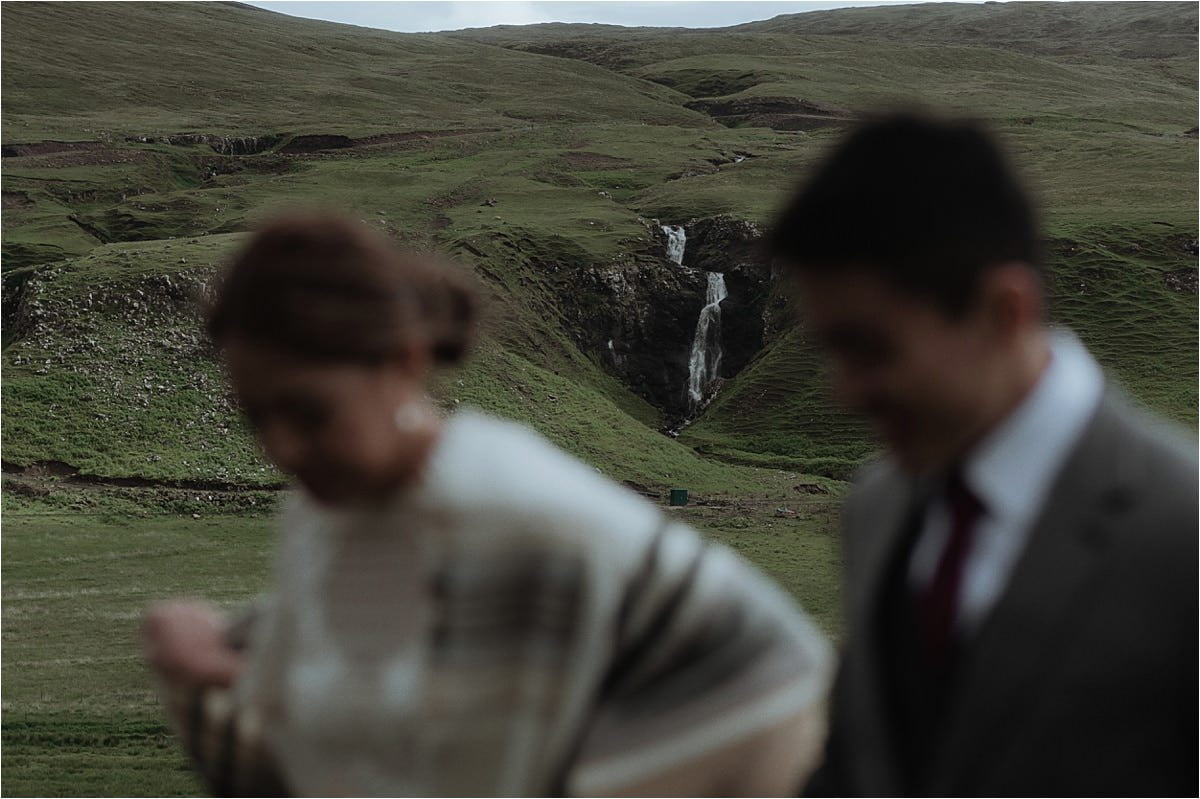 couple and a waterfall in Scotland