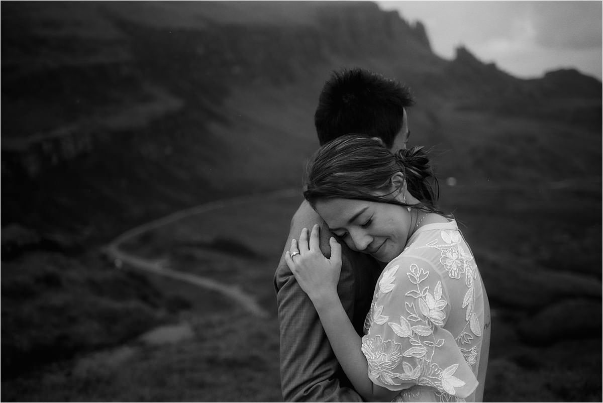 couple hug on skye during thier scottish elopement by Sean Bell photography