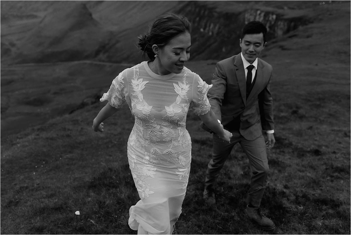 bride and groom runnin gduring isle of skye elopement