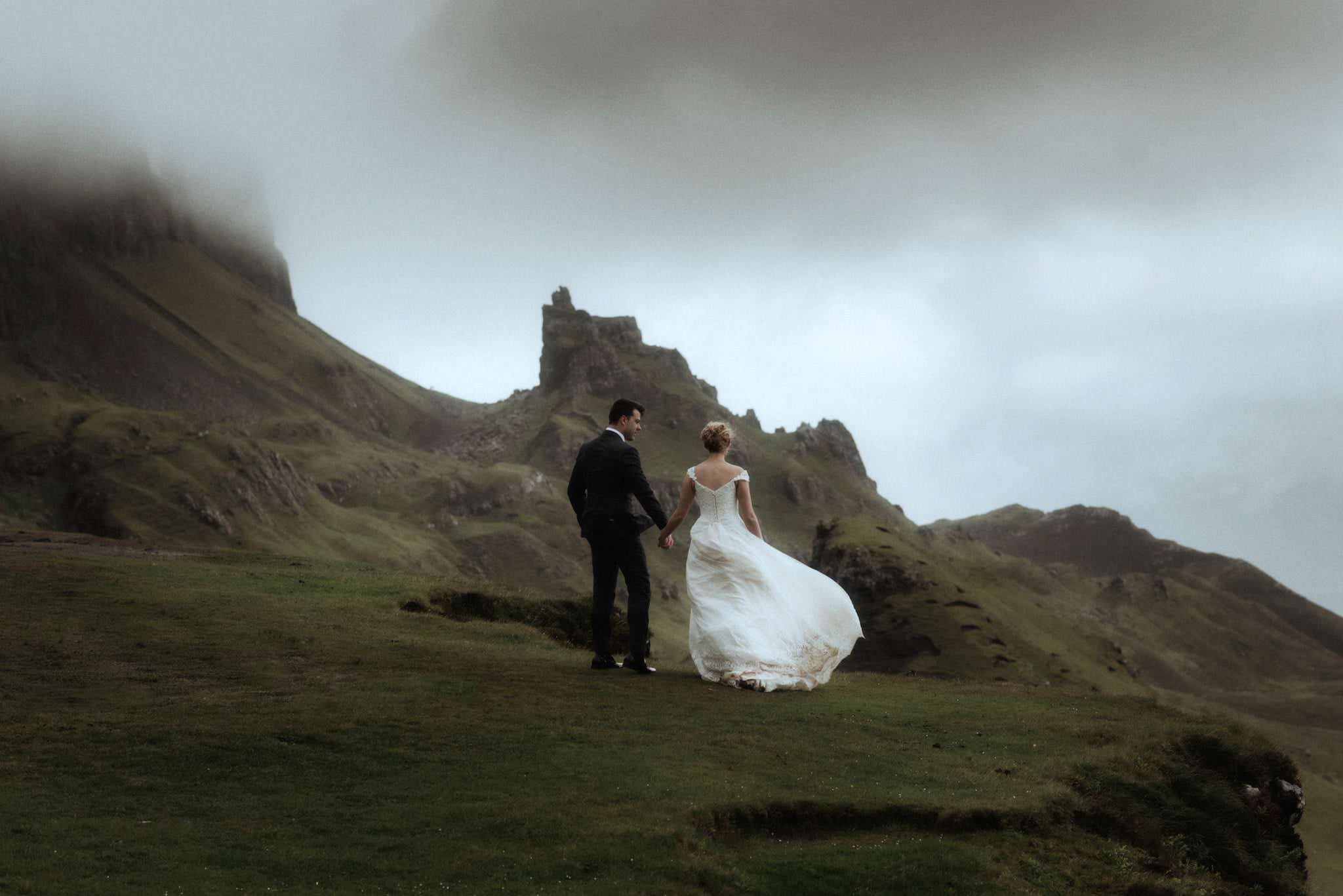elope scotland couple standing on a mountain in isle of skye
