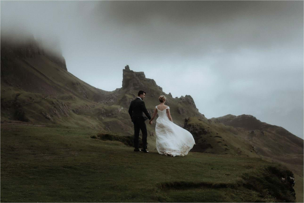 bride and groom standing in the mountains on Skye