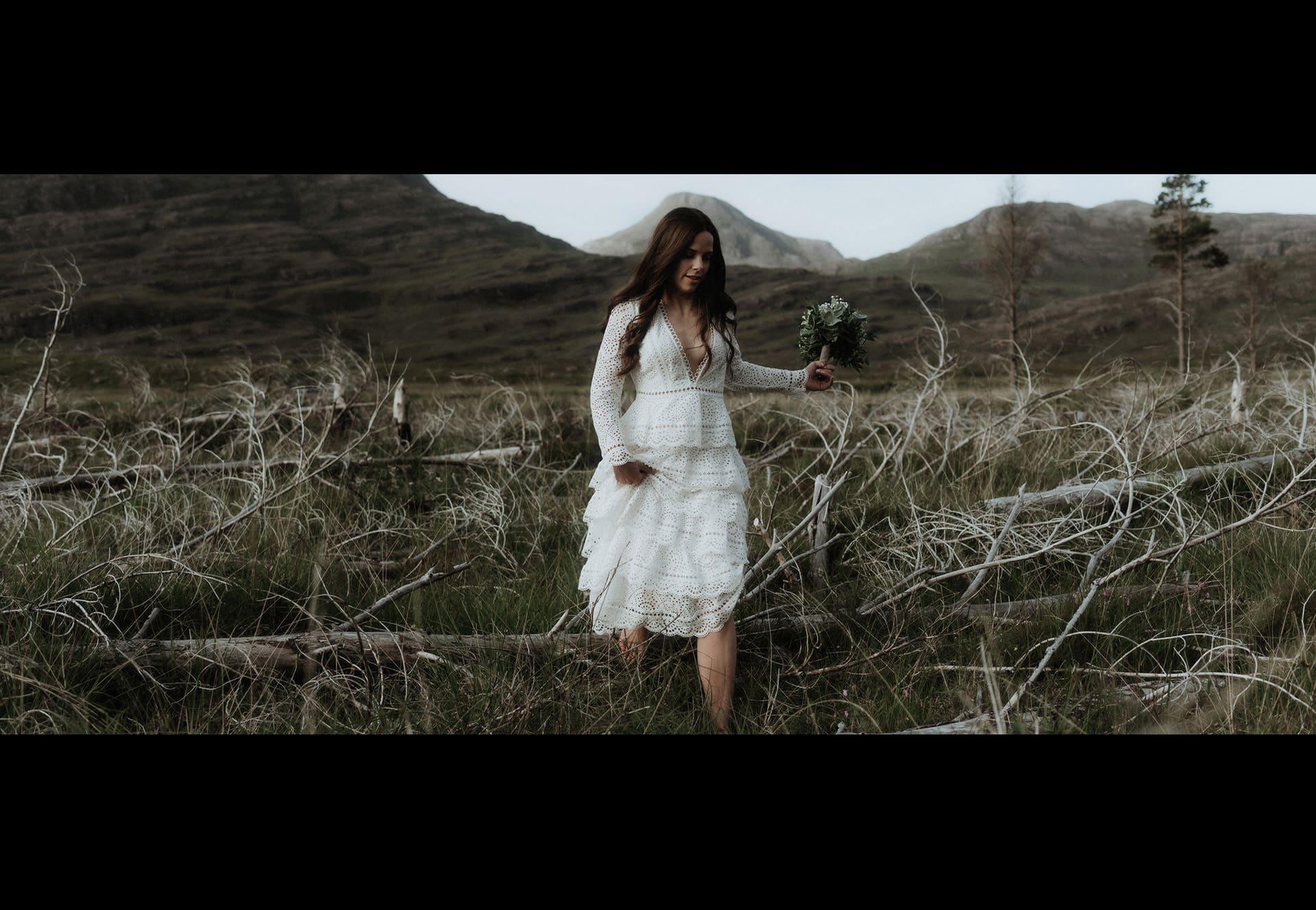 bride walking through marshland in Torridon