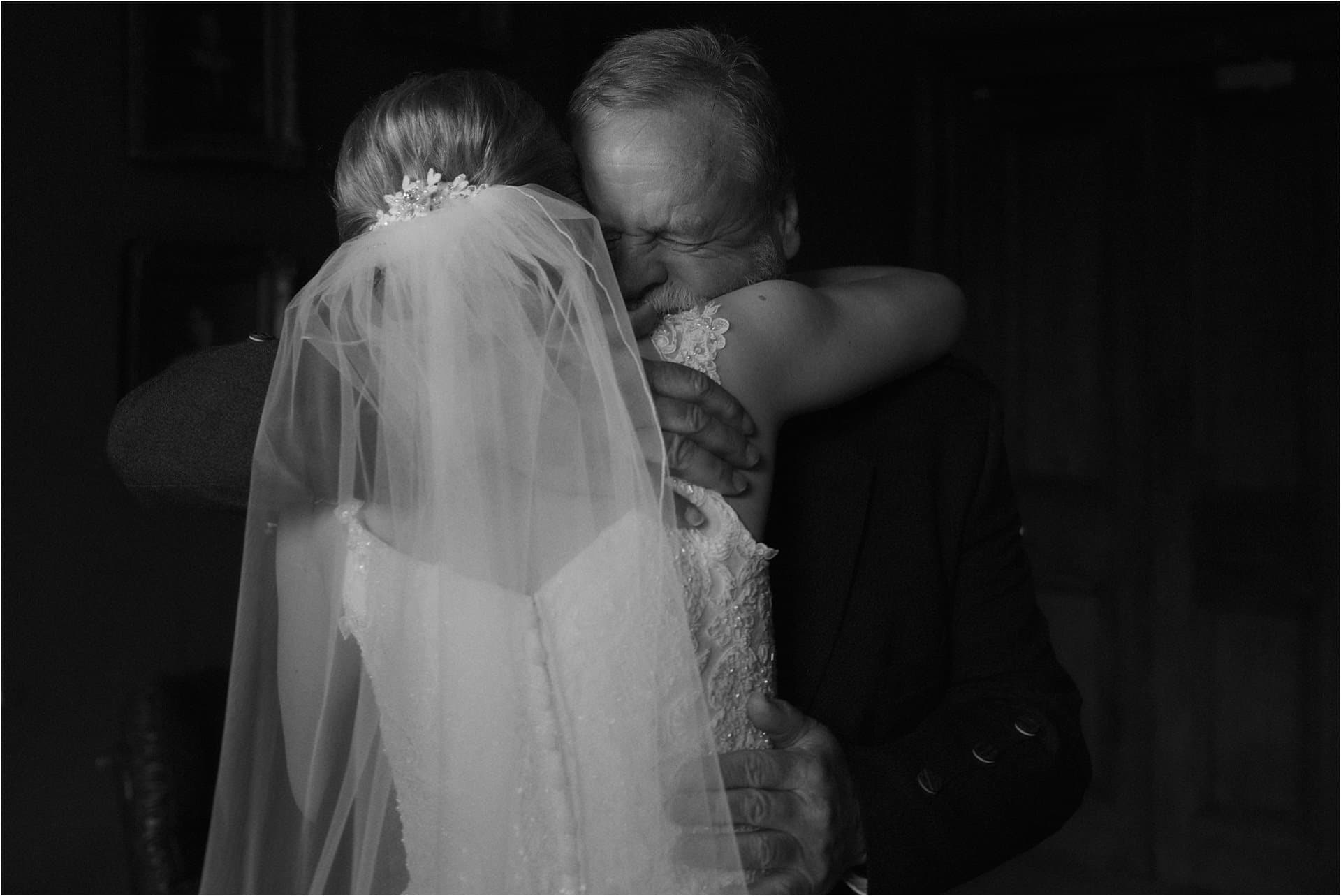 father sees bride for first time at wedding