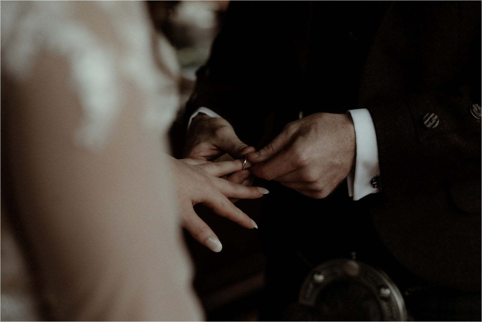 bride and groom ring exchange during a wedding in scotland