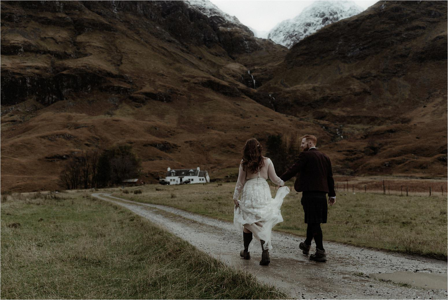 bride and groom in Glencoe mountains during scottish elopement
