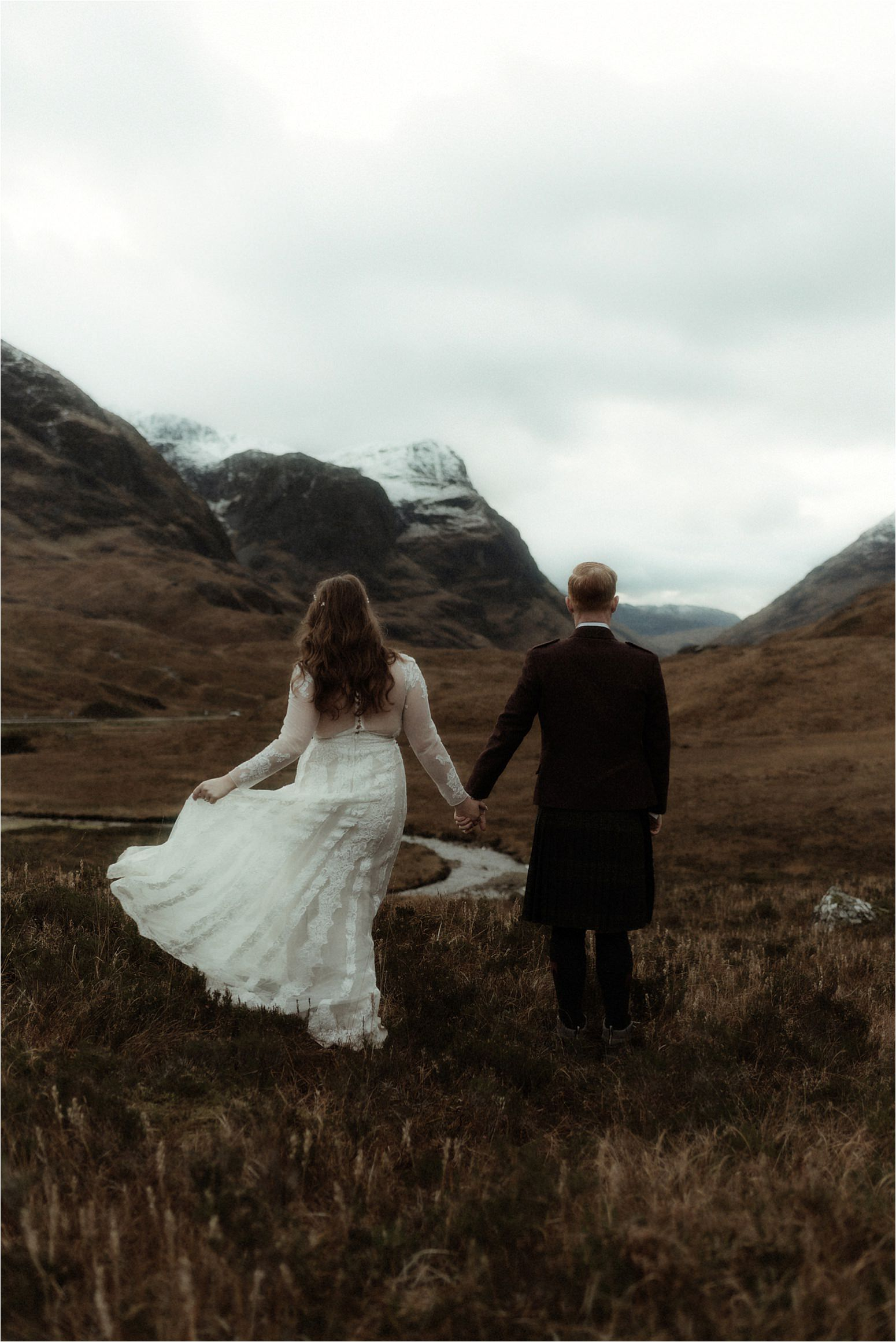 glencoe elopement couple walking in the mountains