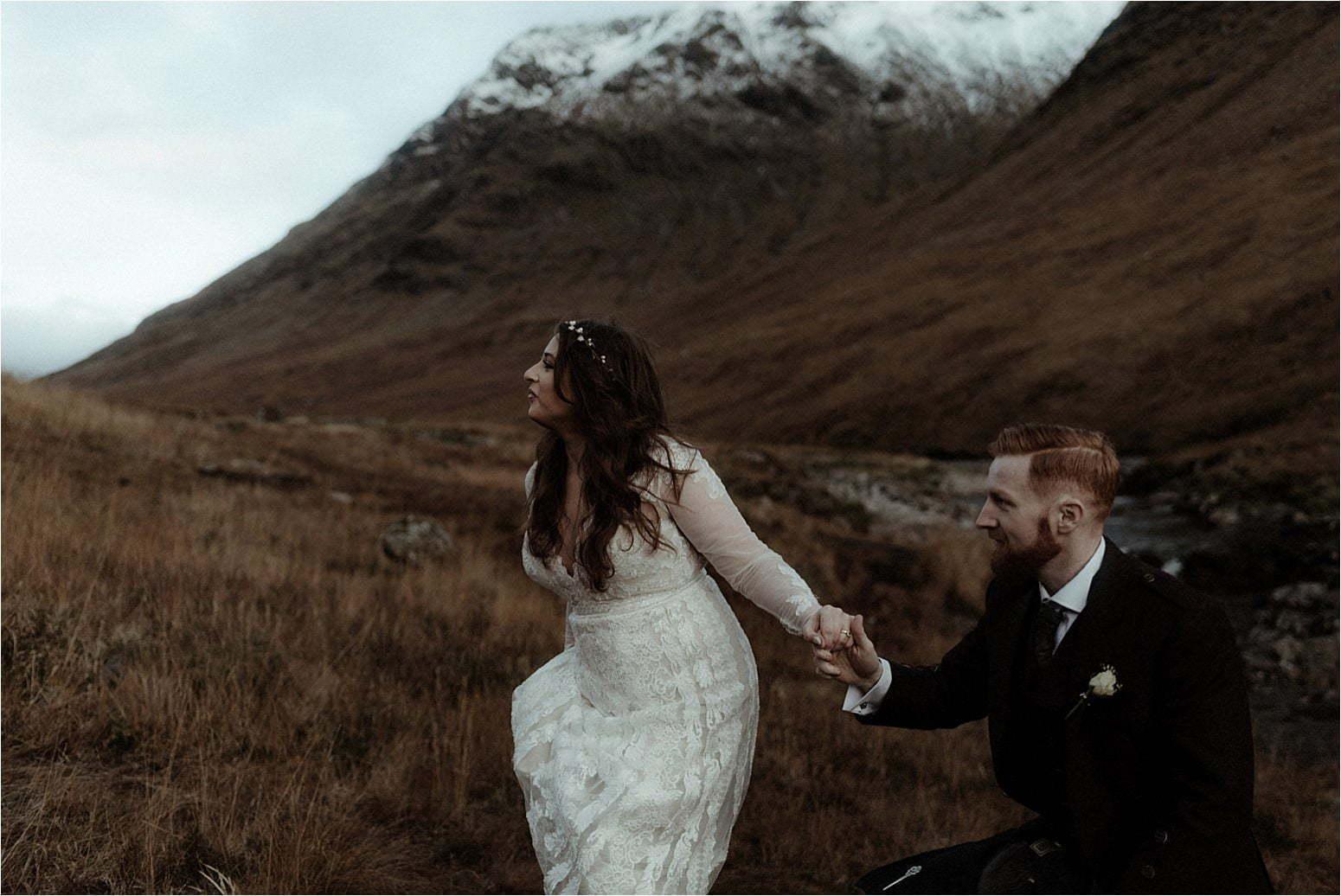couple walking in glen etive during elopement in scotland