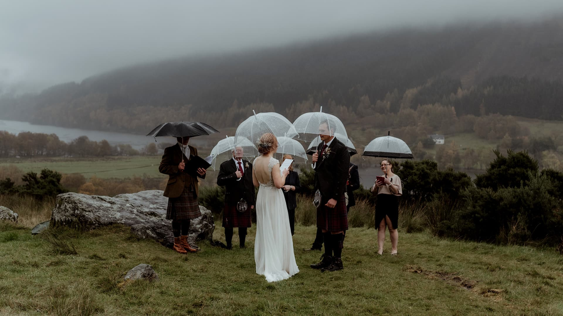 elopement ceremony taking place in scotland highlands in the rain