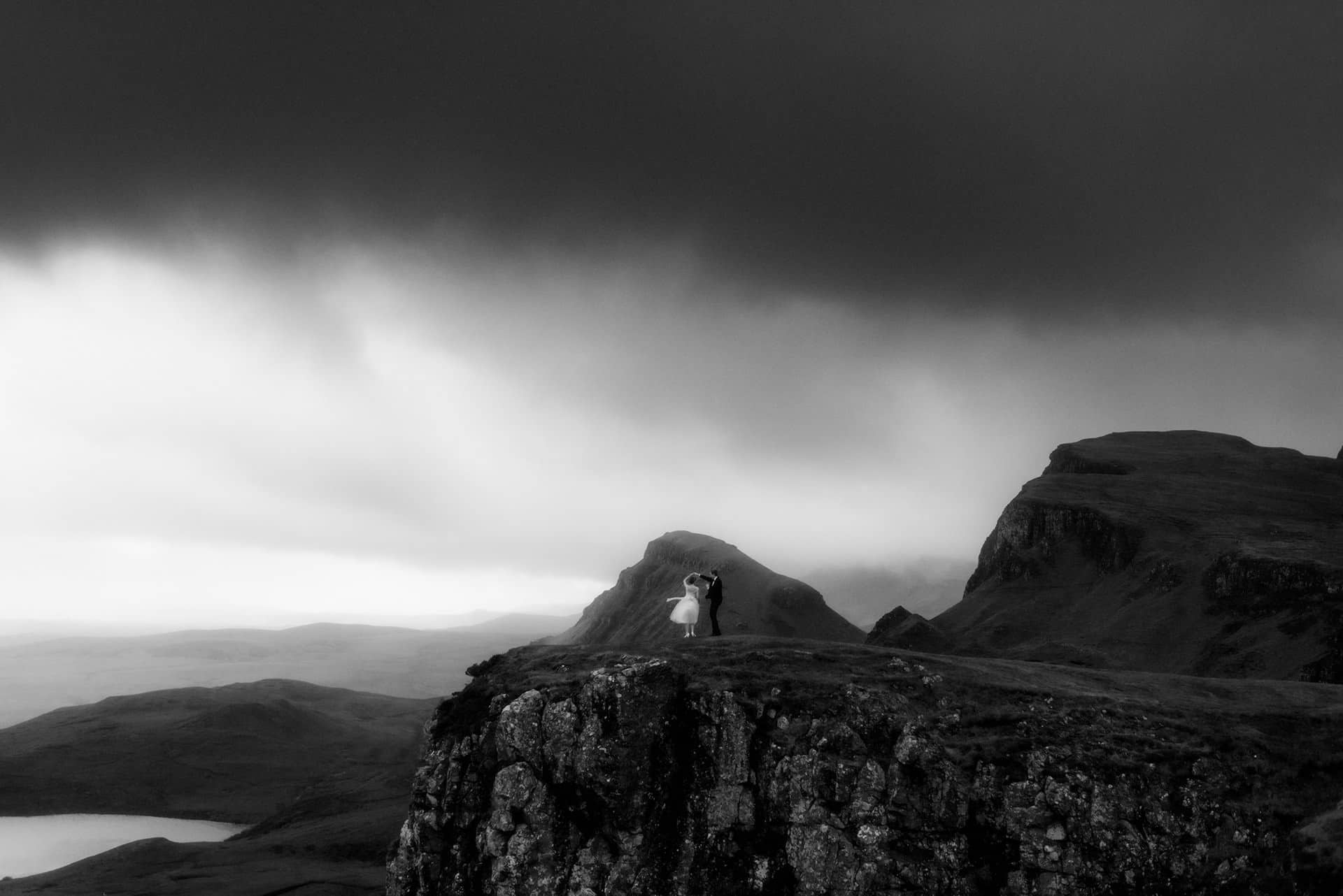 bride and groom dancing on the isle of Skye in the mountains of the Quiraing