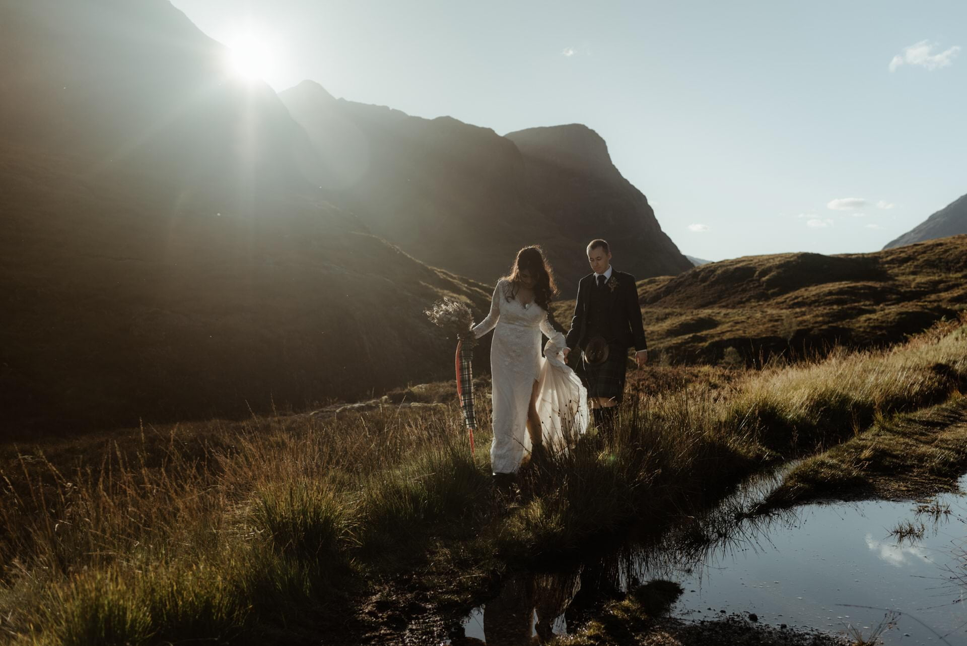 couple walking during thiner Glencoe elopement in scotland