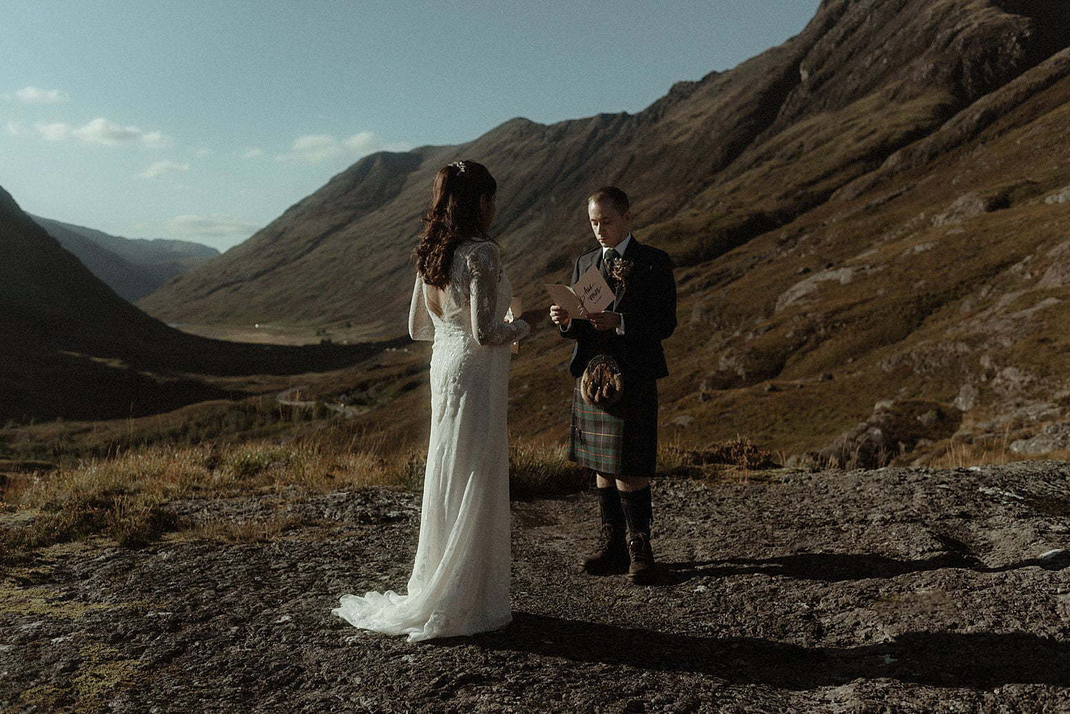 A bride and groom saying their vows during their elopement in Scotland