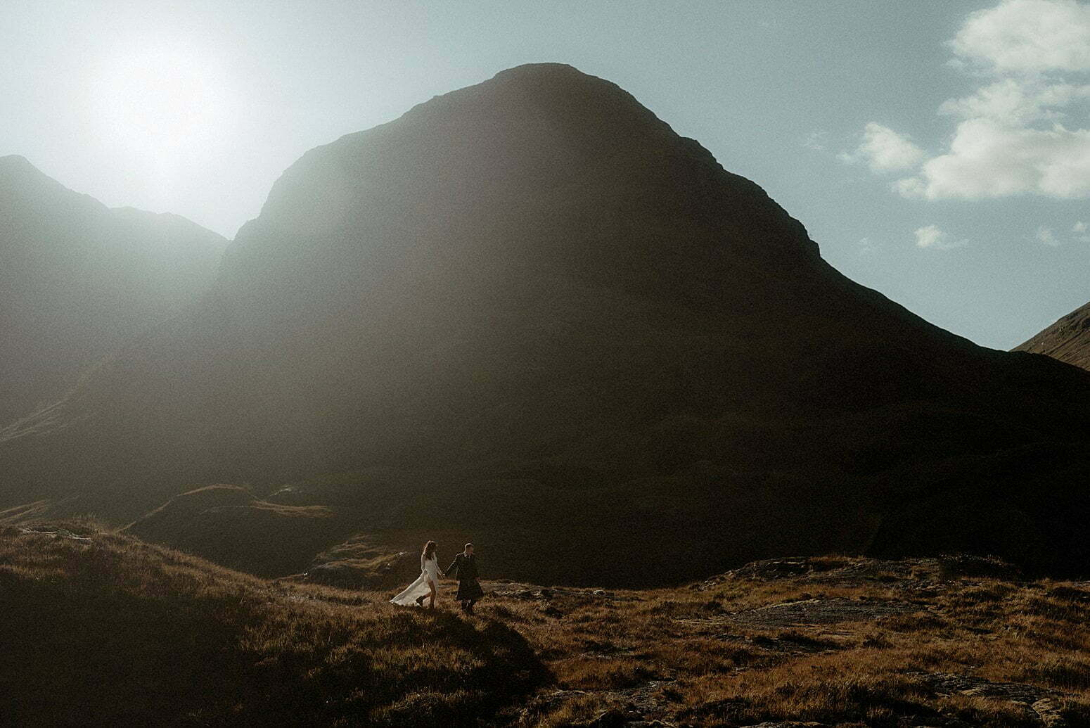 Autumn elopement in Scotland couple walking in the mountains of Glencoe