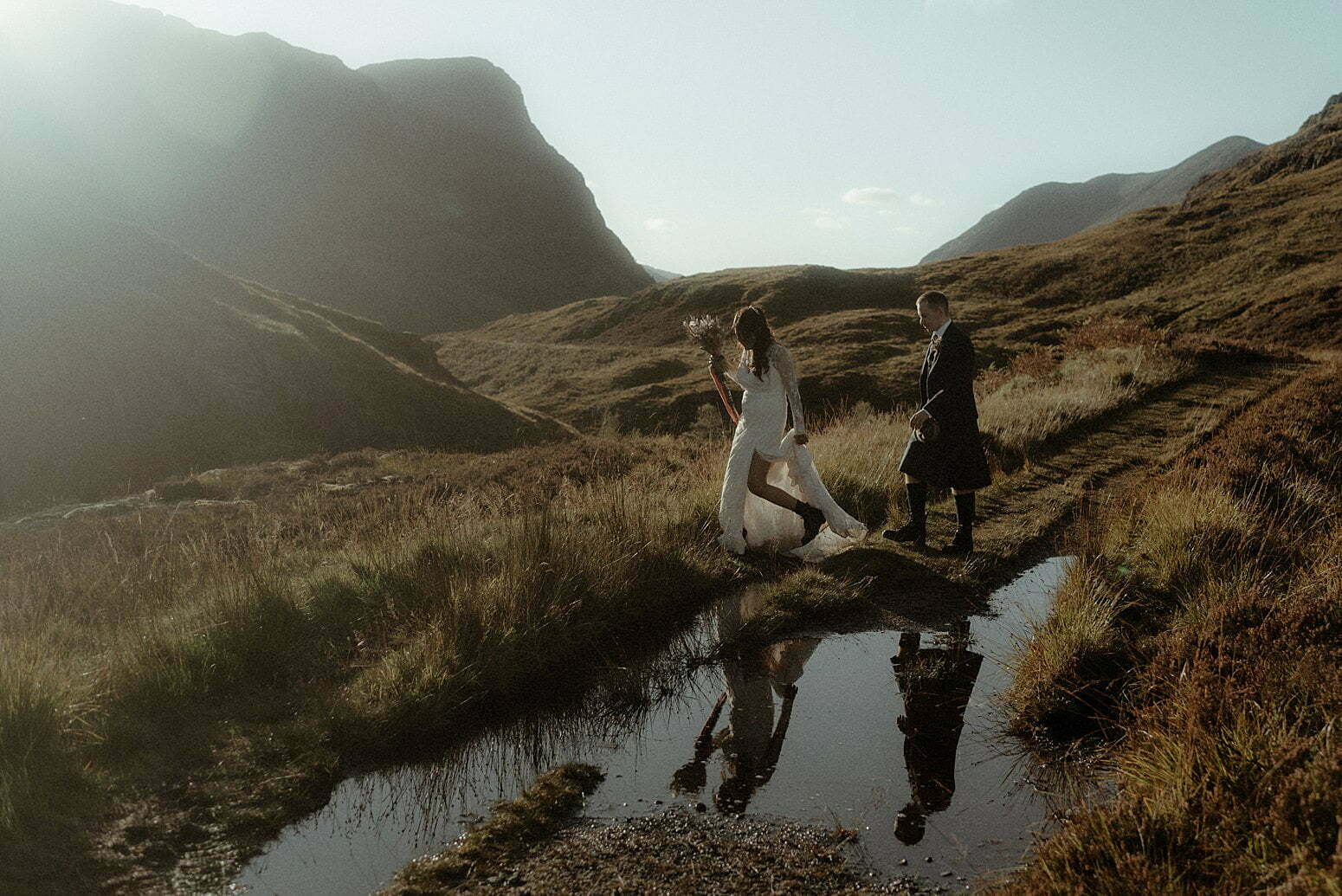elopement Scotland couple walking in the mountains of Glencoe