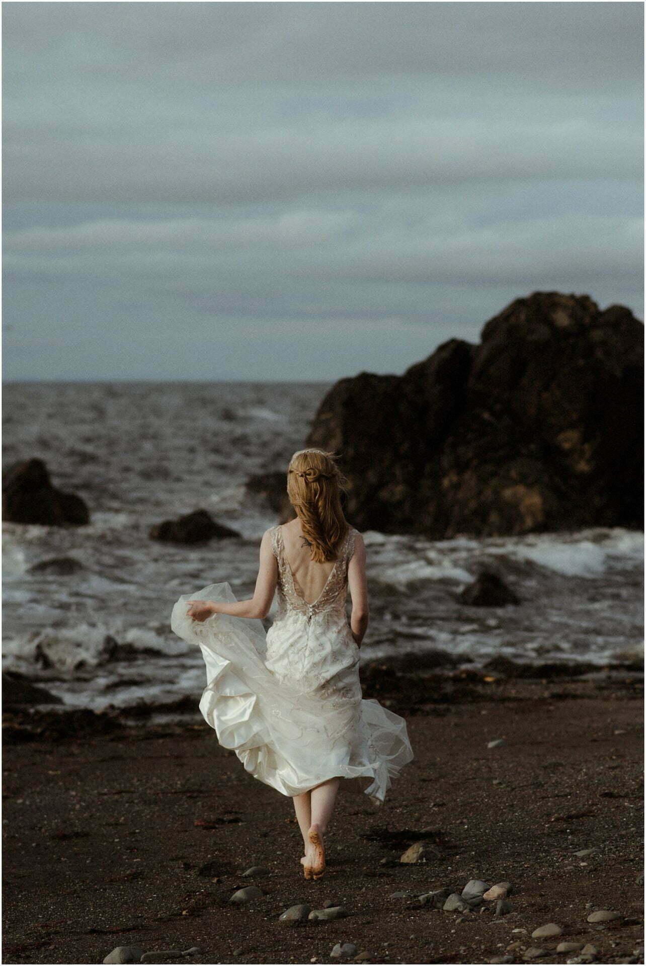 bride running on a beach in scotland
