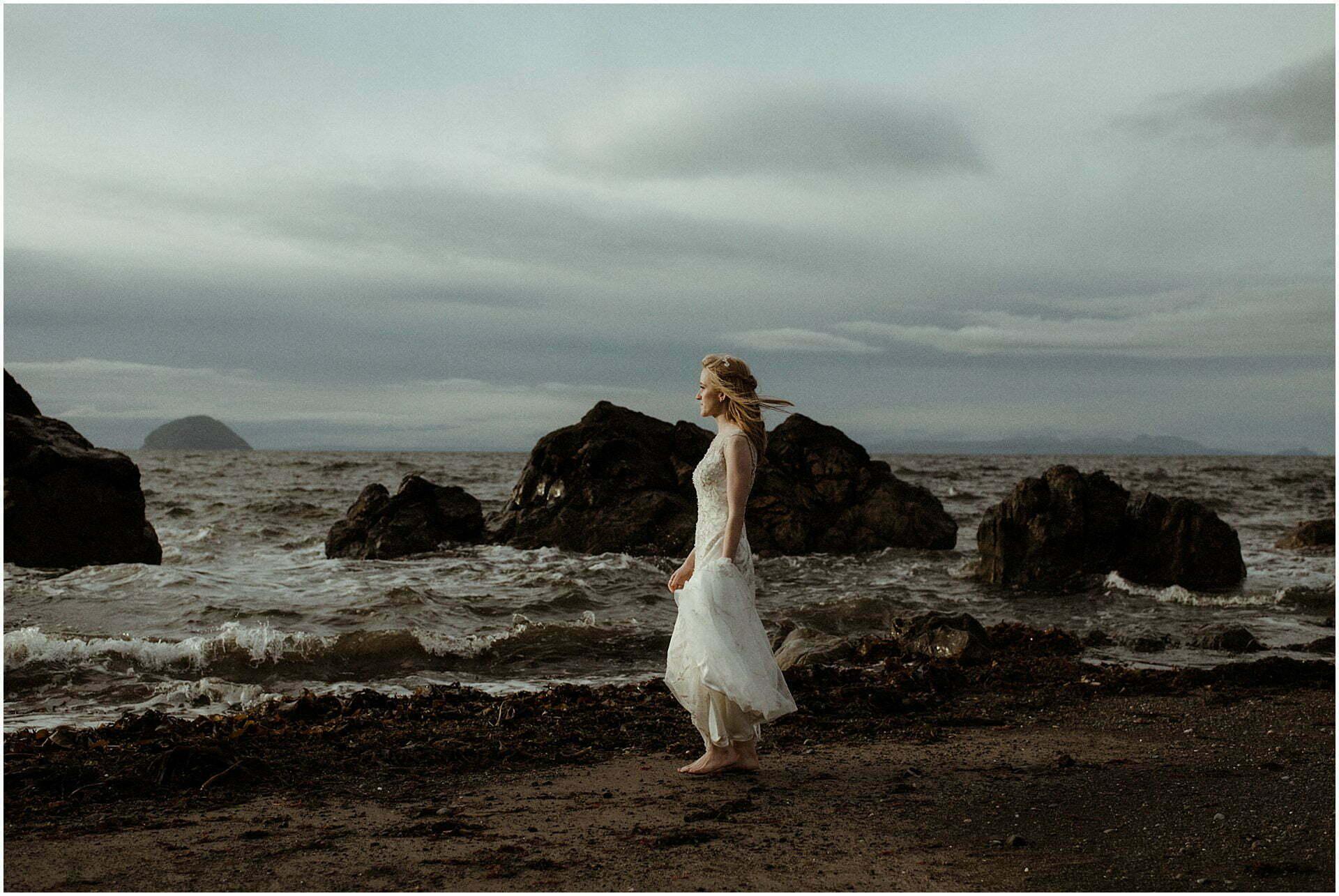 scotland elopement bride walking on a beach