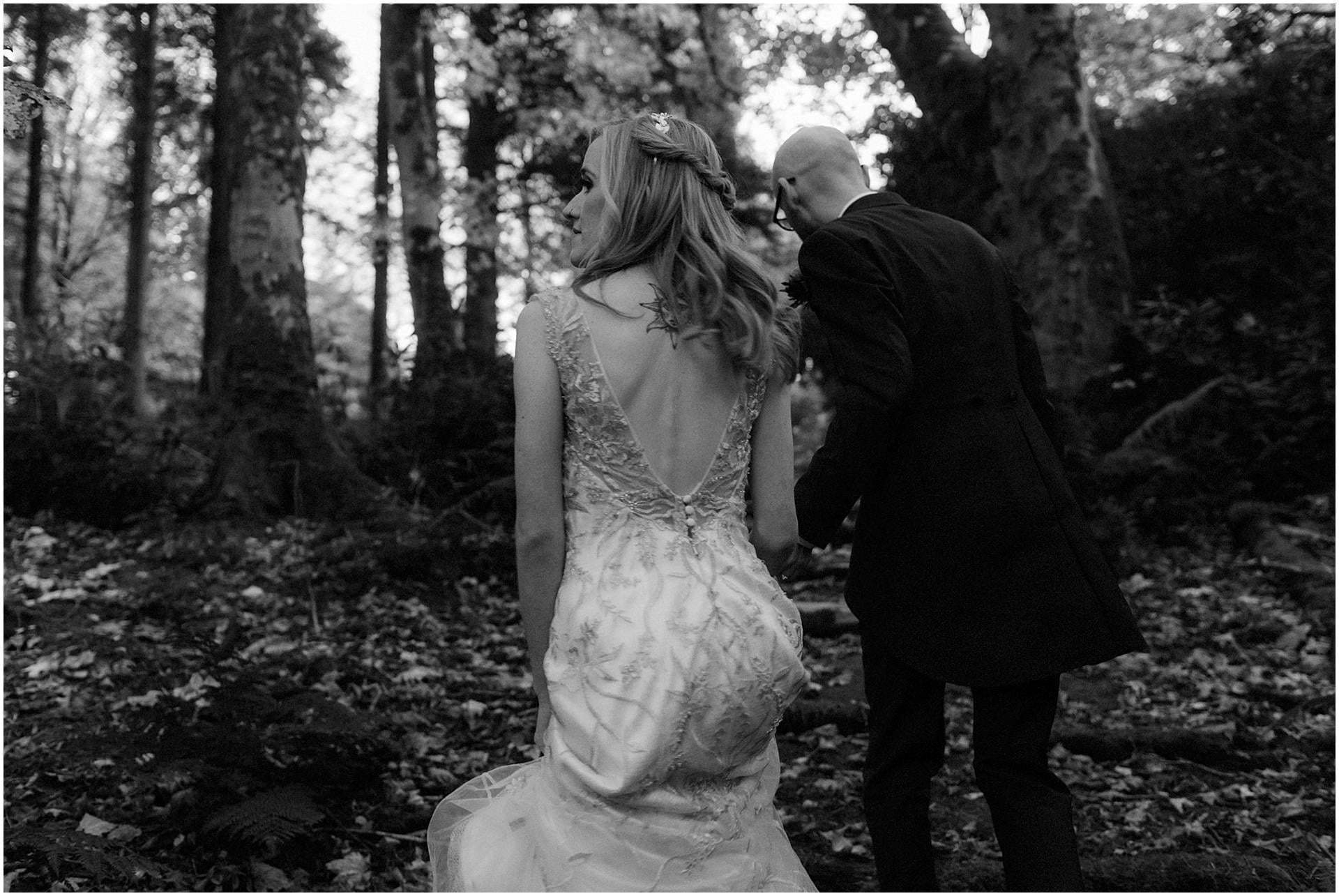 Scotland elopement on the West coast bride and groom walking in woodland