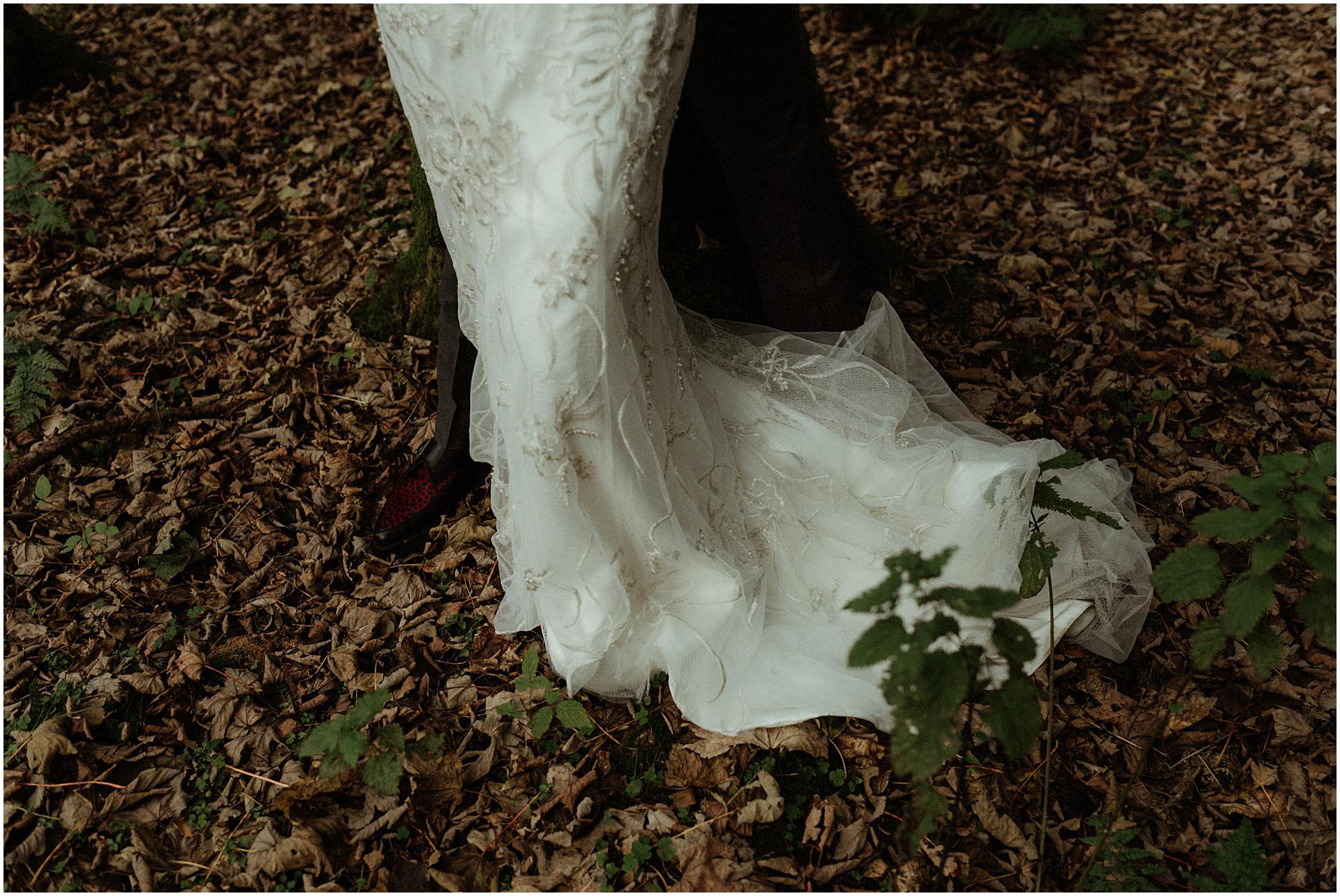 elope Scotland bride and groom walking in woodland
