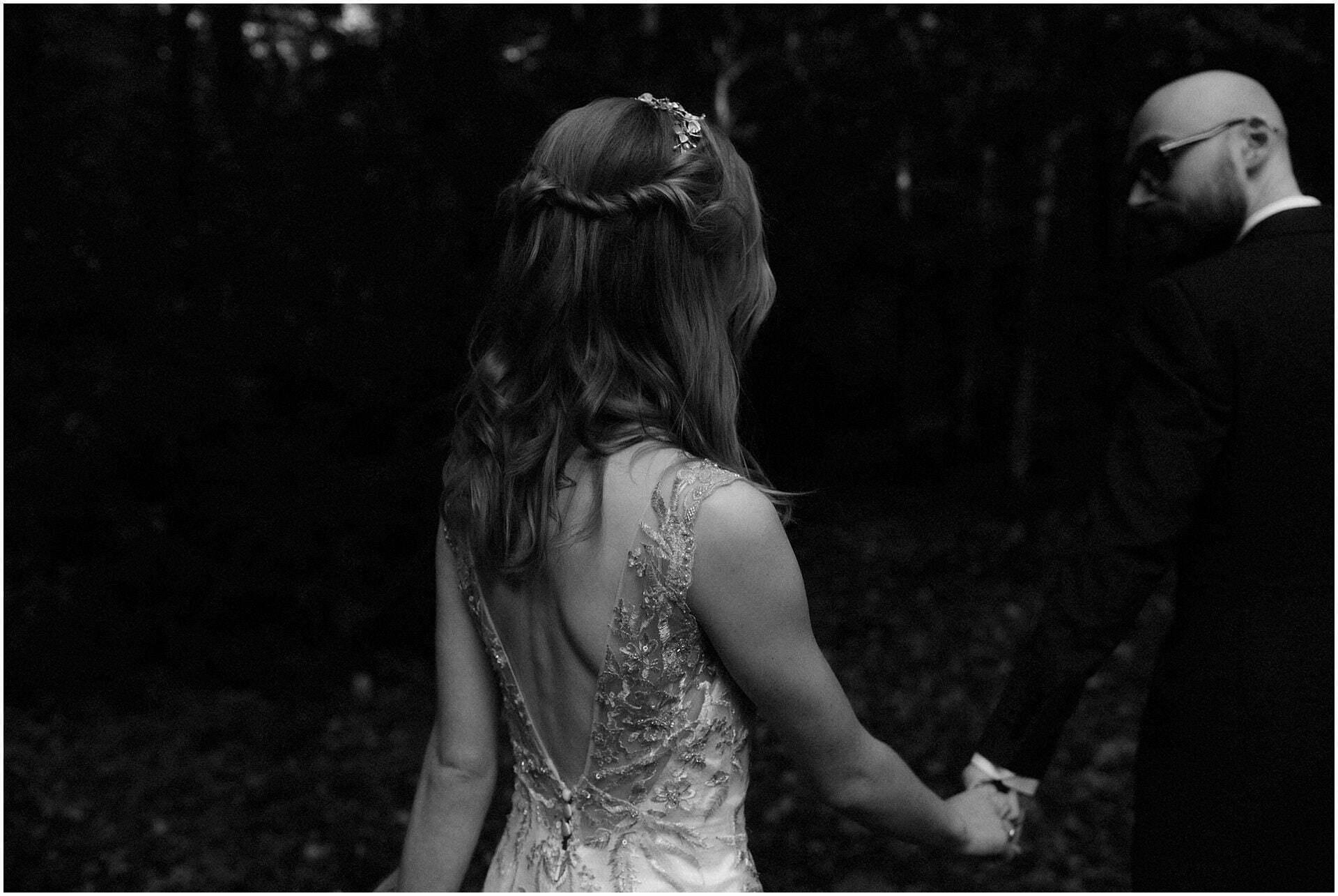 eloping in scotland bride walking in woodland