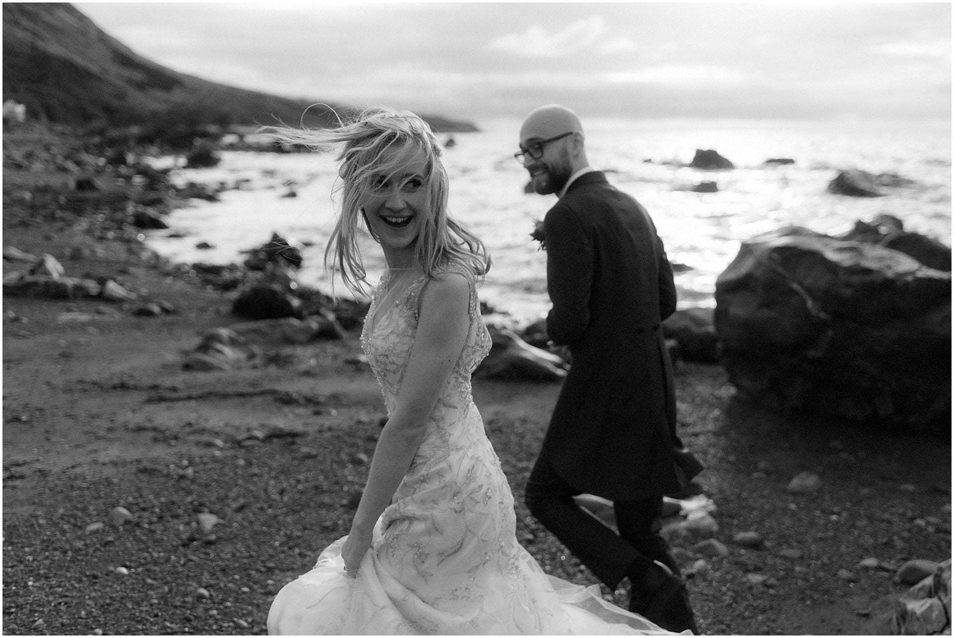 elope in Scotland bride and groom walking on the beach in Ayrshire
