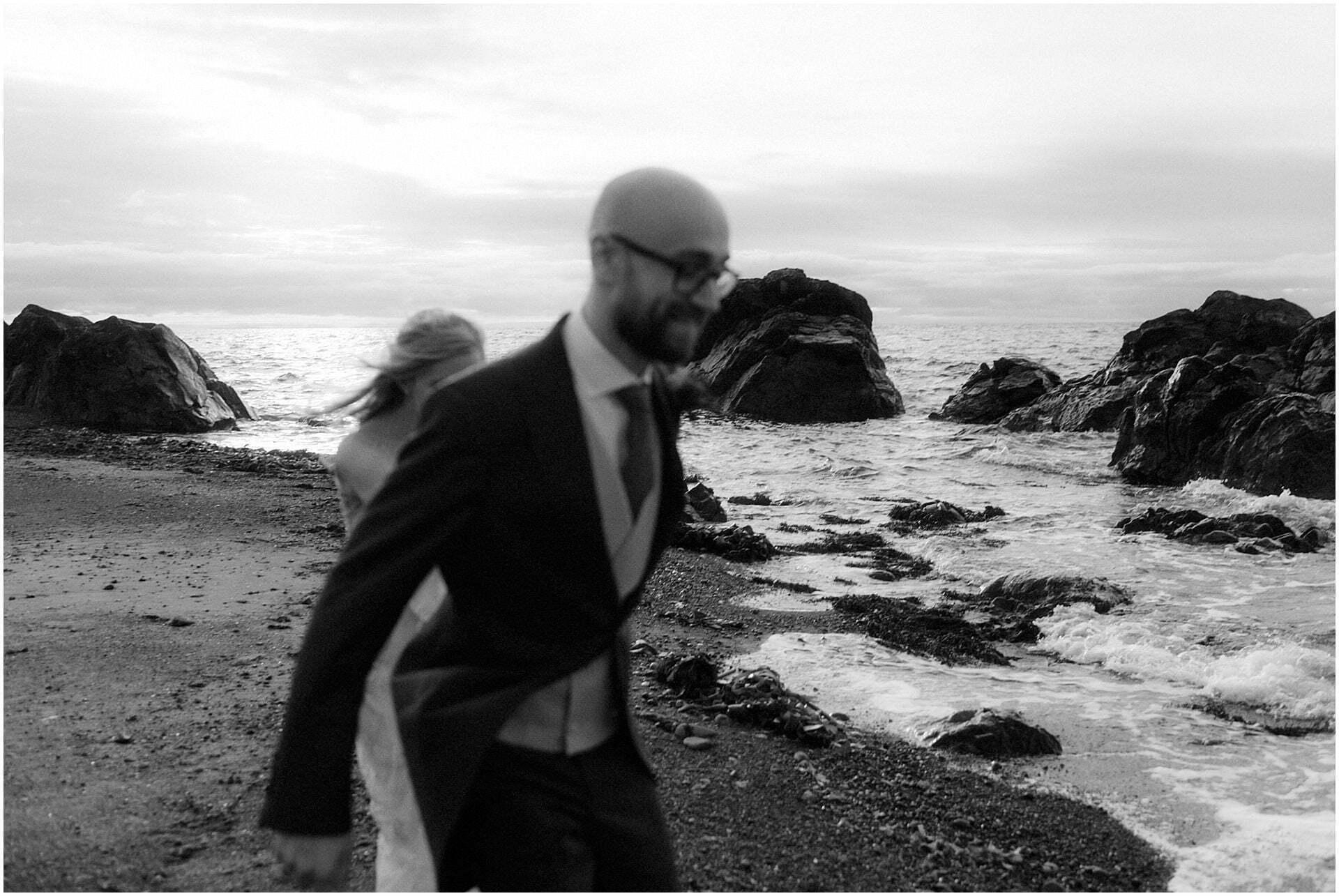 Scotland elopement on the West coast couple walking on beach