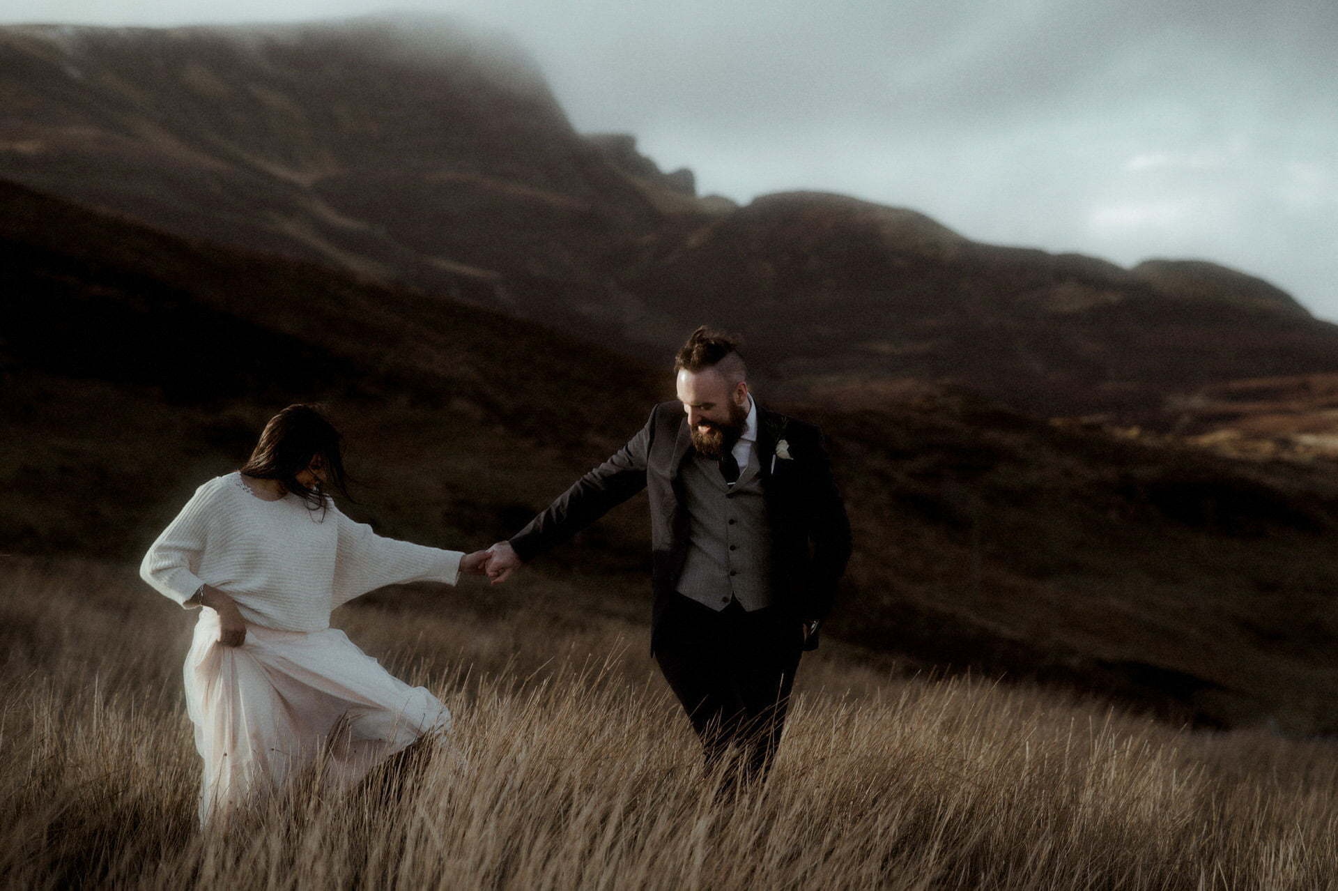 a bride and groom in the mountains of Isle of Skye during their elope to scotland