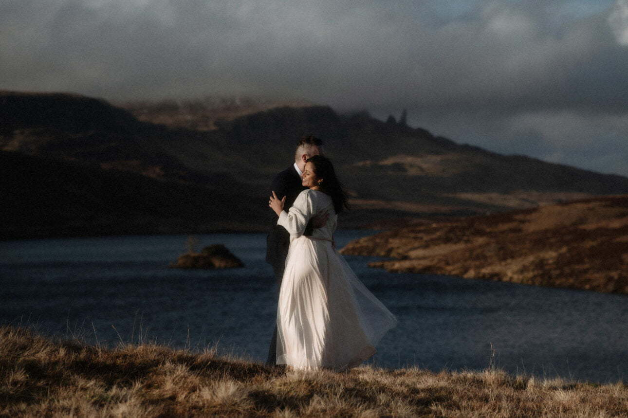 bride and groom dancing near the old man of store mountains during an isle of skye elopement