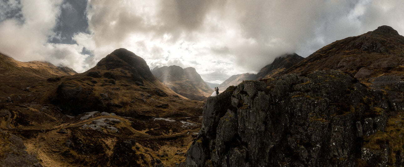 epic landscape of Glencoe with an elopement couple standing in the mountains
